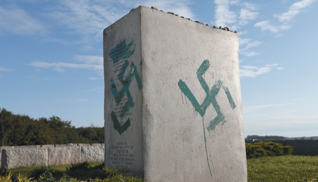 A monument to the Jews killed in 1941 in Jedwabne, Poland, which was erected in 2001 and vandalized with swastikas ten years later, September 2011
